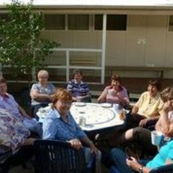 Ladies from the Patchwork group enjoy a break in the courtyard
